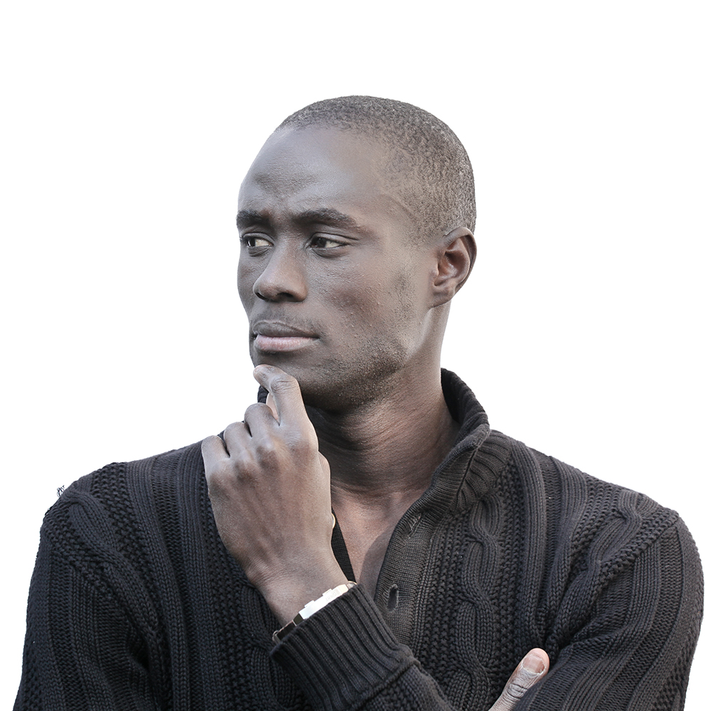 Man looking to the left with hand on chin in thinking position